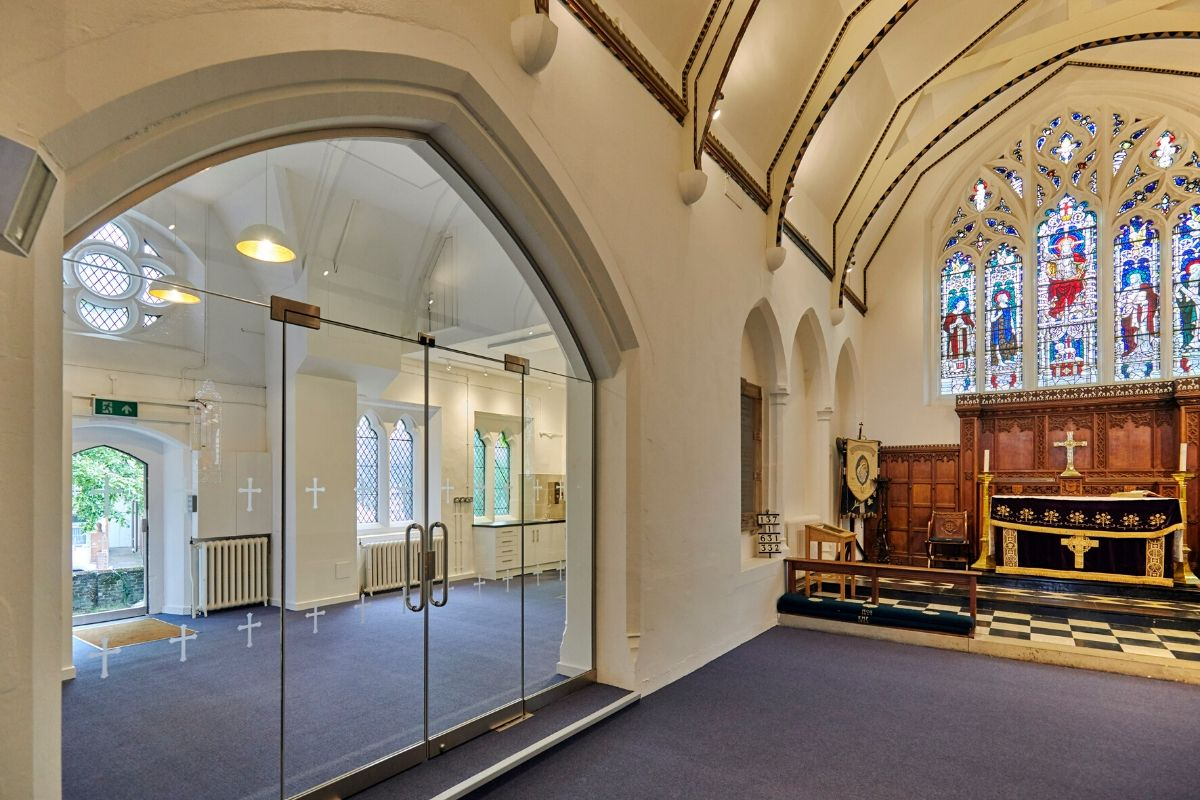 Double frameless glass doors installed to arched screen, St Mary Church