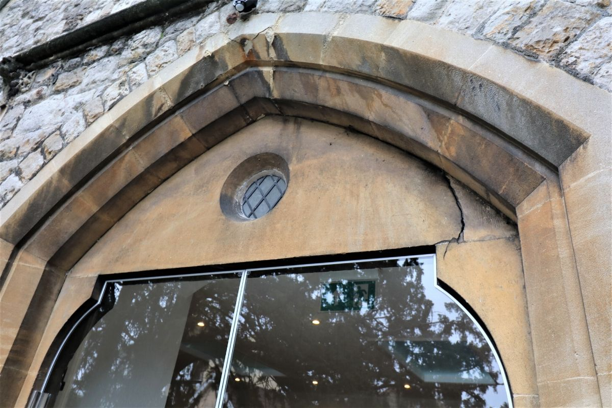 External framless glass doors fitted to stone work, St Mary Church