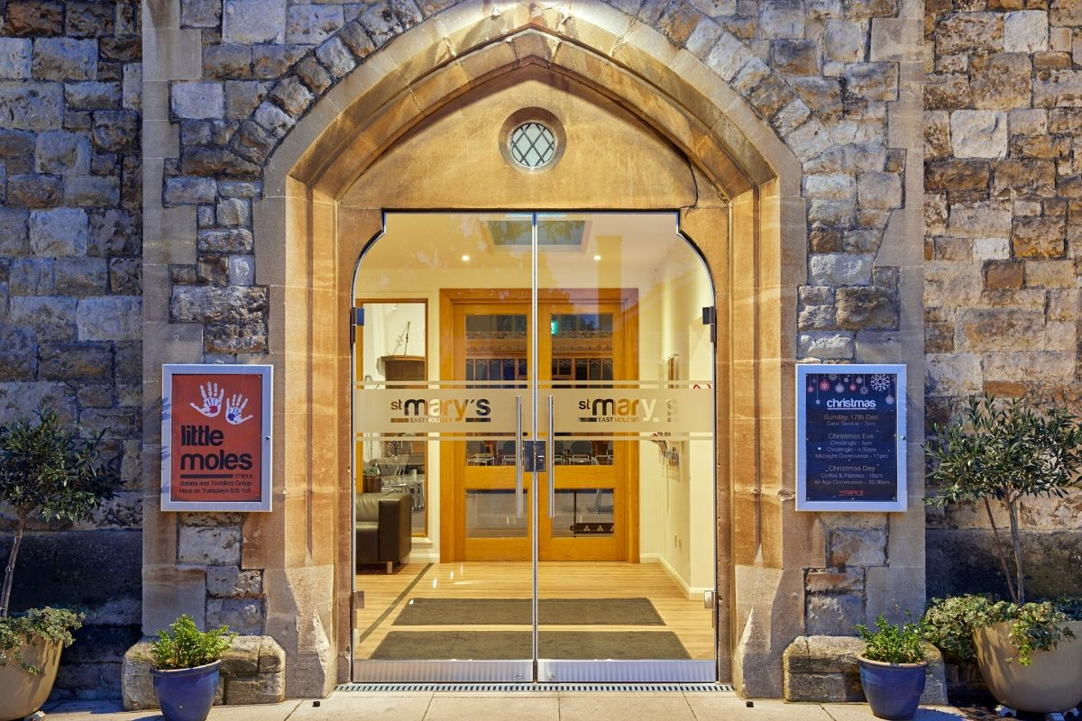 External secure external glass doors fitted to stone work, St Mary Church
