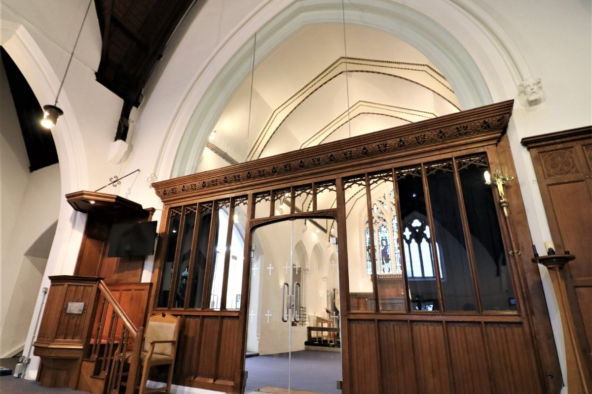 Glass Screen and doors behind historic wooden pannels at St Mary Church