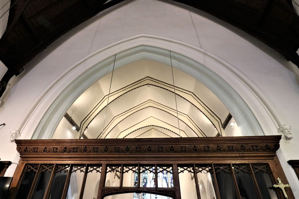 Oversized glass screen with arch, St Mary Church